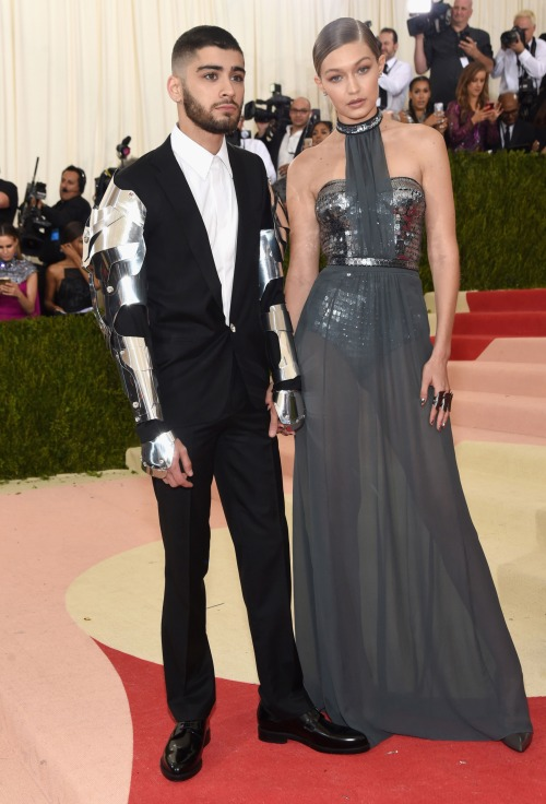 Gigi Hadid in Tommy HIlfiger and Zayn in Versace